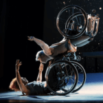 Two dancers with wheelchairs, from Kinetic Light's performance of Descent